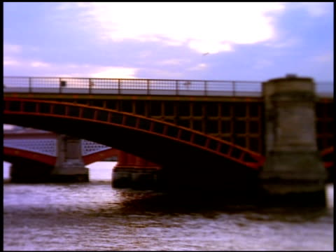 pan left along blackfriars railway bridge and blackfriars bridge in background with stylised focus effect, london - railway bridge stock videos & royalty-free footage