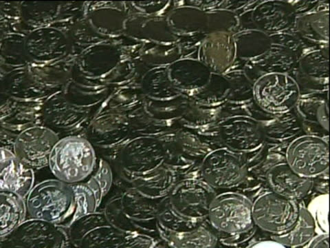 pan left along pile of 10 cent republic of namibia coins - silver metal stock videos and b-roll footage