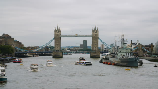 pan left along the south bank of the river thames to tower bridge - tower of london stock videos & royalty-free footage