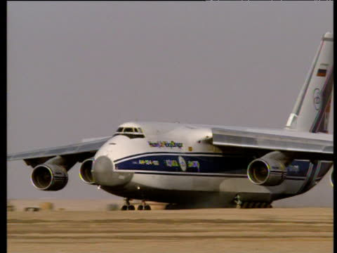 pan left as large freight plane lands at airport jordan - 1994 stock videos and b-roll footage