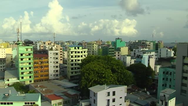 Pan left city shot Male Maldives