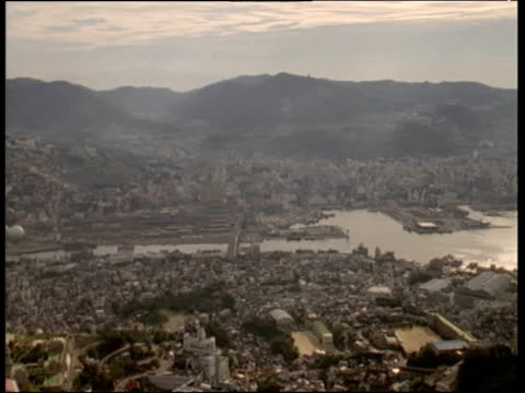 pan left from harbour over city and mountains nagasaki - 1997 stock videos and b-roll footage