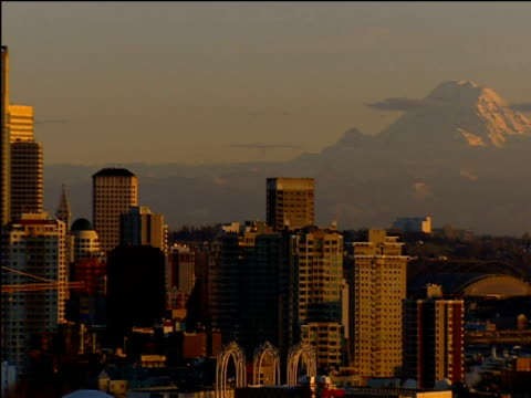 Pan left from Mount Rainier to high rise buildings and Space Needle