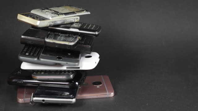 pan left from multiple cell phones, e-waste multiple discarded electronic appliance sold mobile smart cell phones - stack stock videos & royalty-free footage