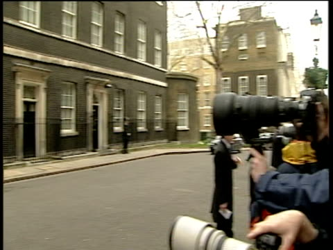 pan left from paparazzi to number 11 downing street westminster london - downing street stock videos and b-roll footage
