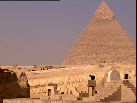 pan left from pyramid to sphinx egypt - tomb stock videos & royalty-free footage