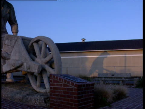 pan left from shadow to large statue of gold prospector california - gold rush stock videos and b-roll footage