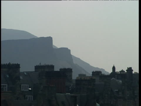 pan left from tron church spire arthur's seat and salisbury crags in background edinburgh - spire stock videos & royalty-free footage