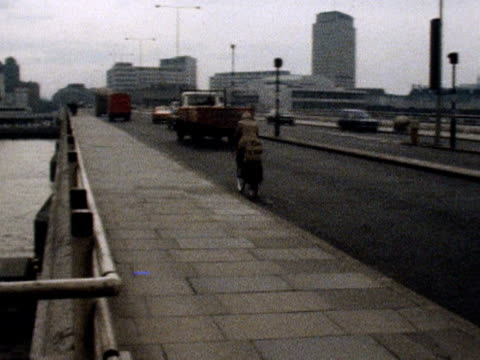 pan left from waterloo bridge to the new national theatre on the southbank of the thames march 1976 - 1976 stock videos and b-roll footage