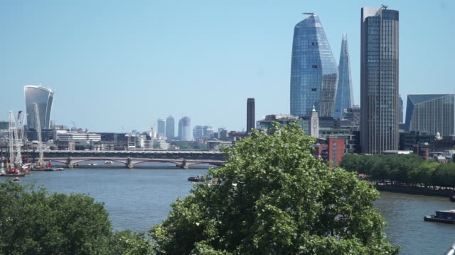 Pan left of Blackfriars bridge from the Oxo tower on a sunny day in London