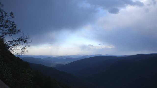 Pan left onto clouds over the Greater Blue Mountains World Heritage Area in New South Wales, Australia.