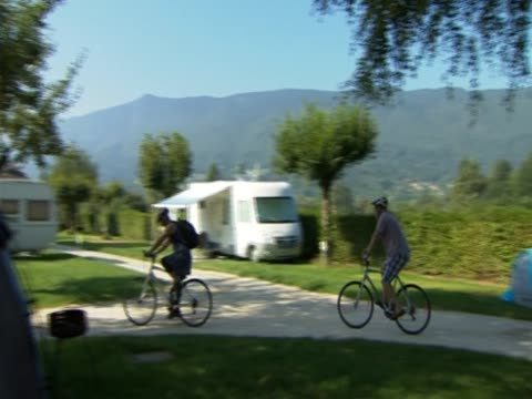 pan left over camping site annecy france - camper van stock videos & royalty-free footage