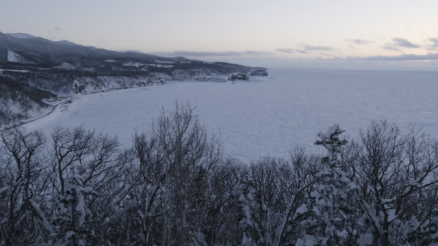 pan left over coast and sea ice. - satoyama scenery stock videos & royalty-free footage