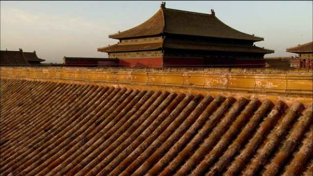 Pan left over crowds milling in front of Meridian Gate, Forbidden City, Beijing