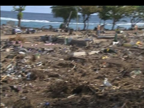 stockvideo's en b-roll-footage met pan left over destroyed village following deadly earthquake samoa indonesia 2 october 2009 - samoa