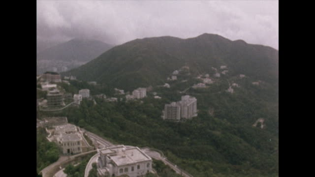 pan left over hong kong and victoria harbour; 1972 - britische kultur stock-videos und b-roll-filmmaterial