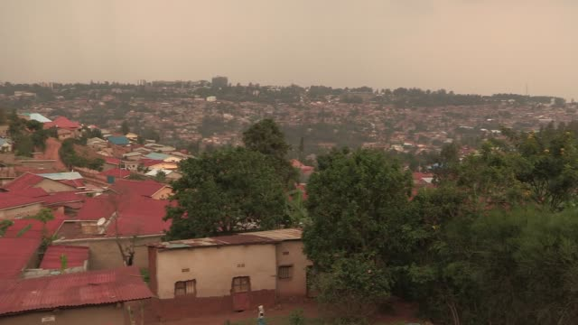 Pan left over houses in western rural Rwanda