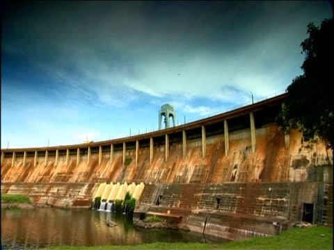 pan left over hydro electric dam river nile uganda - dam stock videos & royalty-free footage