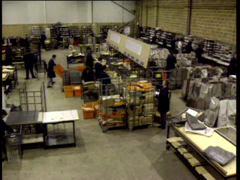 pan left over large postal sorting area - postal worker stock videos & royalty-free footage