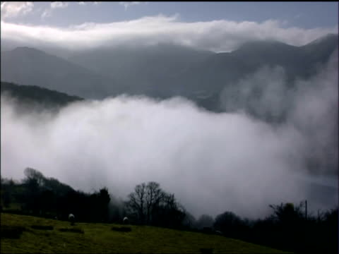 pan left over mist in valleys of snowdonia national park - fog stock videos & royalty-free footage