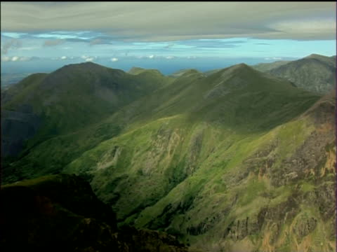 pan left over mountains and valleys of snowdonia national park - snowdonia stock videos & royalty-free footage