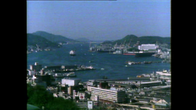 pan left over nagasaki city and harbour; 1981 - nuclear bomb stock videos & royalty-free footage