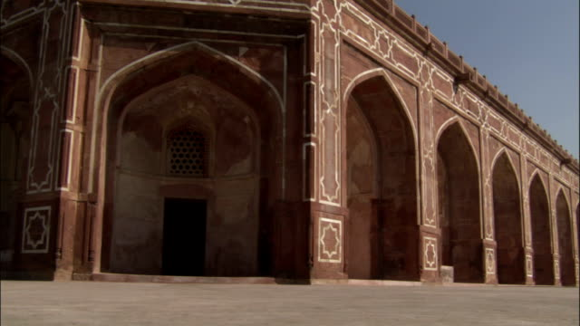 Pan left over ornate archways of Humayun's Tomb Available in HD.