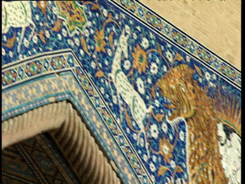 pan left over ornate mosaic archway of mir-i arab madrasah bukhara uzbekistan - bukhara stock videos & royalty-free footage