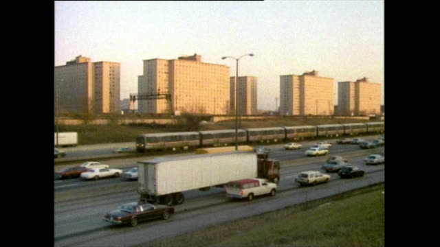 pan left over road and railroad towards housing projects: chicago, 1985 - 1985 stock videos & royalty-free footage