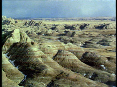 pan left over rock formations of south dakota badlands - badlands national park stock videos & royalty-free footage