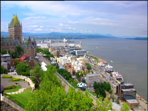 Pan left over St. Lawrence river and harbour to Chateau Frontenac hotel