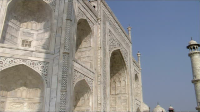 pan left over taj mahal, agra - mausoleum stock videos and b-roll footage