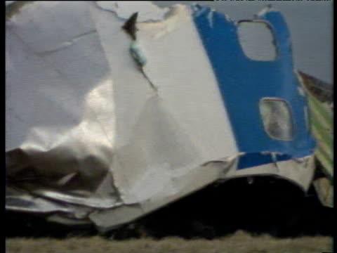 pan left over wreckage of pan am 747 lockerbie air disaster; 22 dec 88 - 航空事故点の映像素材/bロール