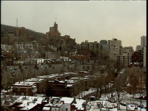vidéos et rushes de pan left past residential and office buildings montreal - montréal