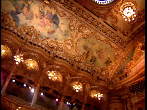 Pan left past stage and ornately painted ceilings