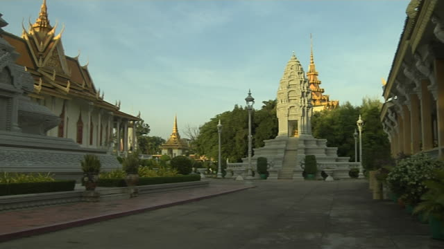 pan left reveal king stupa norodom royal palace phnom penh cambodia - cambodian culture stock videos and b-roll footage