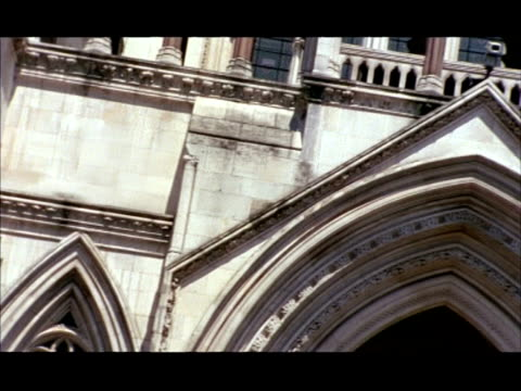 cu pan left, royal courts of justice entrance, angled, london, england - royal courts of justice stock videos & royalty-free footage