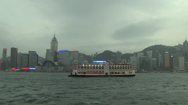 pan left shot ferry in aberdeen harbour hong kong kwangtung china - aberdeen hong kong stock videos & royalty-free footage