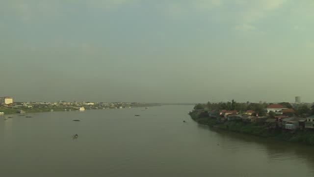 pan left shot mekong river phnom penh cambodia - phnom penh stock videos and b-roll footage