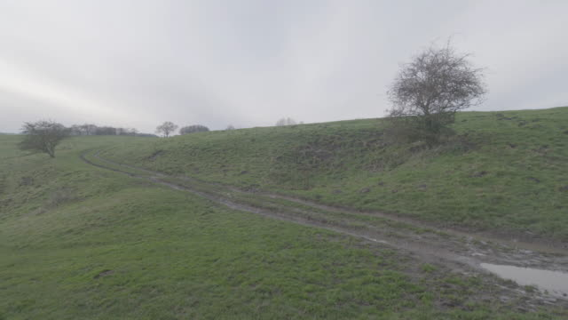 pan left shot of a farmhouse in wharram percy in the deserted medieval village - pasture stock videos & royalty-free footage