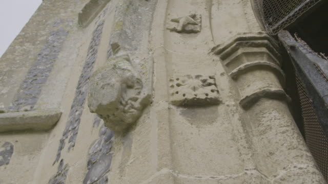 pan left shot of a gothic style gate ornament on the church of st mary in troston - moss stock videos & royalty-free footage