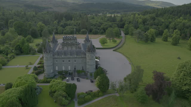 pan left shot of dun na cuaiche and inveraray castle - pasture stock videos & royalty-free footage
