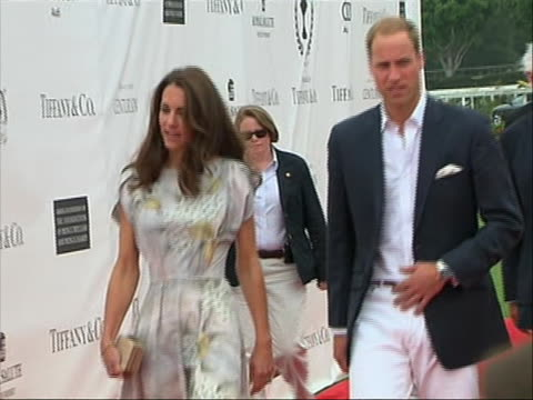 pan left shot of prince william and kate middleton walking down the red carpet at a charity polo event in santa barbara. the polo match celebrated... - santa barbara california stock videos & royalty-free footage