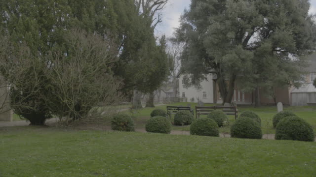pan left shot of the cemetery of the church of st mary the virgin in ashwell - ornate stock videos & royalty-free footage