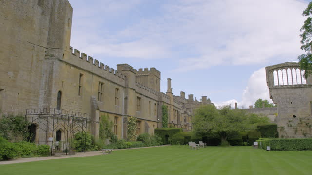 pan left shot of the dungeon tower and the inner court at sudeley castle - british royalty stock videos & royalty-free footage