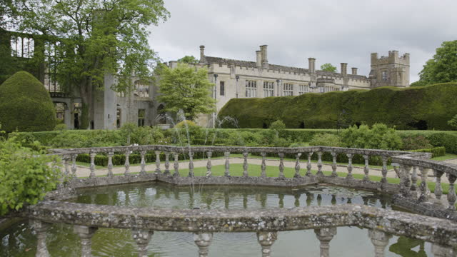 pan left shot of the fountain in the queens garden at sudeley castle - british royalty stock videos & royalty-free footage