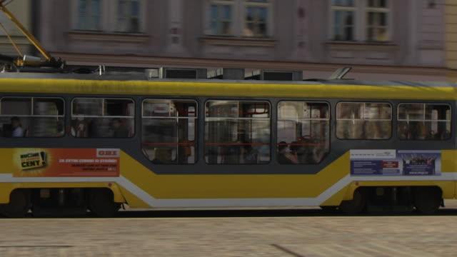 pan left shot pilsen city tram pilsen west bohemia czech republic - czech republic stock videos and b-roll footage