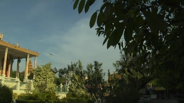 pan left shot reveal silver pagoda royal palace phnom penh cambodia - phnom penh stock videos and b-roll footage