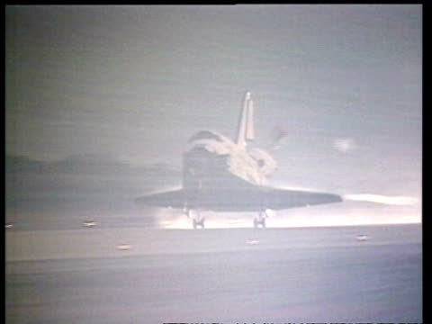 ms pan left, space shuttle landing and deploying chute, nasa - space vehicle stock videos & royalty-free footage