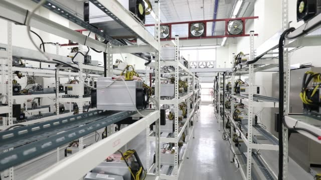 stockvideo's en b-roll-footage met pan left to right applicationspecific integrated circuit devices and power units manufactured by bitmain technologies inc sit on shelves at a... - incheon